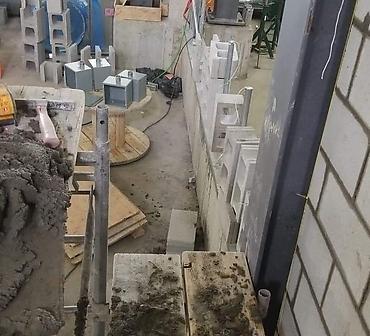 Construction mur de blocs de beton a Montreal - Construction d'une séparation en bloc de béton, bloc de construction, division de classe école de plomberie à Montréal