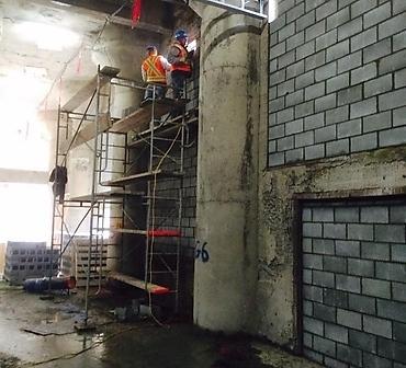 Pose de bloc de beton Montreal - Installation de bloc de béton, bloc de construction Hochelaga, obstruction des ouvertures dans des murs de béton extérieur au vieux Port de Montréal