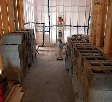 Preparation de cage ascenseur en bloc de beton a Longueuil - Pose de blocs de béton pour la cage d'escalier et cage d'ascenseur, installation de blocs cage ascenseur