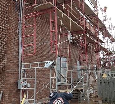 Restauration de mur de brique Rosemont - Réparation mur de brique, ventre de boeuf Rosemont, démanteler mur de brique complet et réinstaller la brique récuperée à 100%