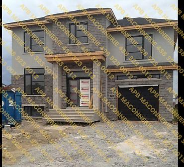 Pose de blocs architecturaux - Projet de pose de blocs architecturaux et brique Permacon Travaux effectues sur une construction neuve a Beloeil