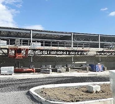 Installation de blocs de beton a Longueuil - Blocs de construction pour séparation mur écran dans un entrepôt de matériaux, le bloc de béton le meilleur matériel à installer pour ses propriétés coupe-feu, il ne moisira jamais et est très résistant